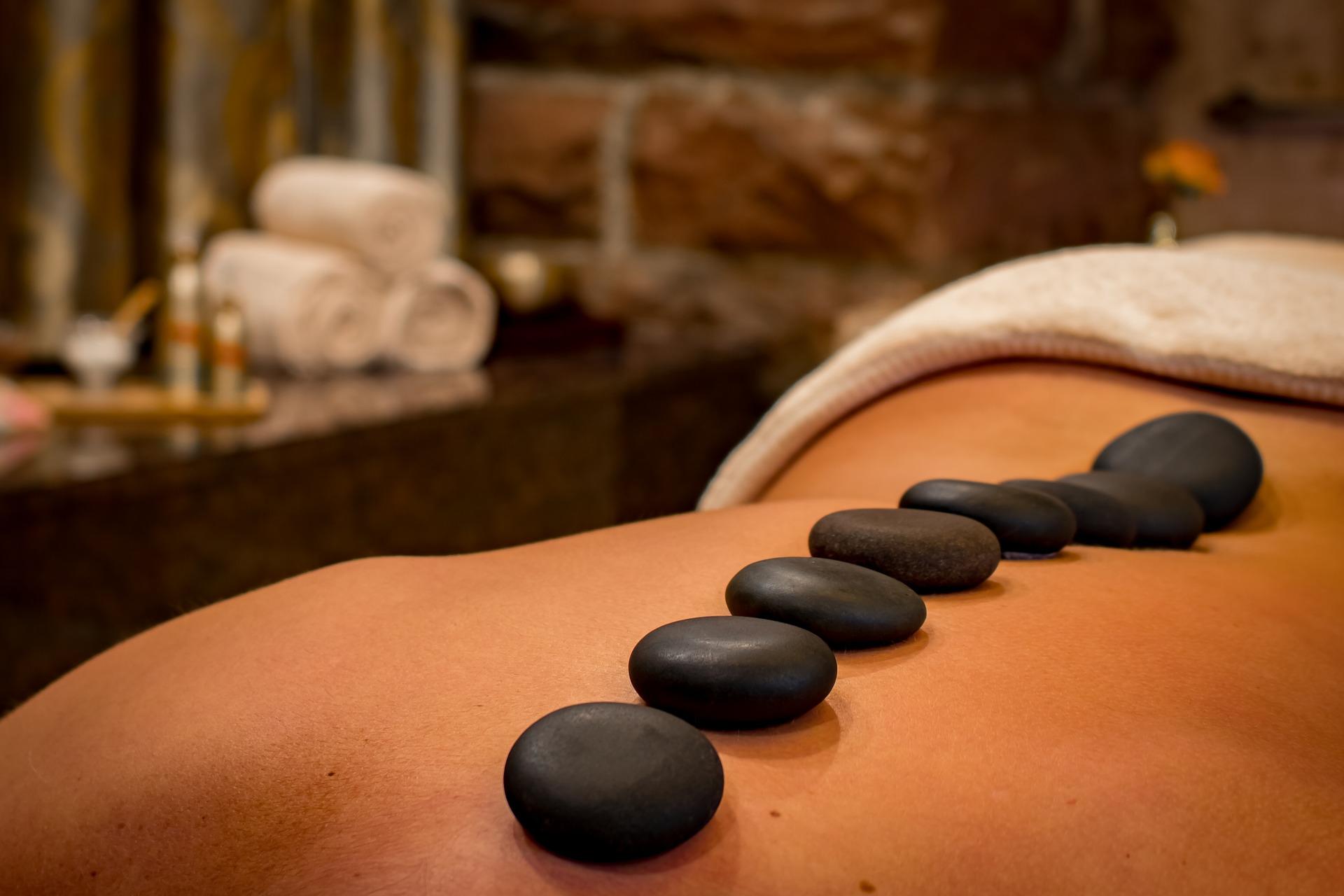 hot stone massage on a woman