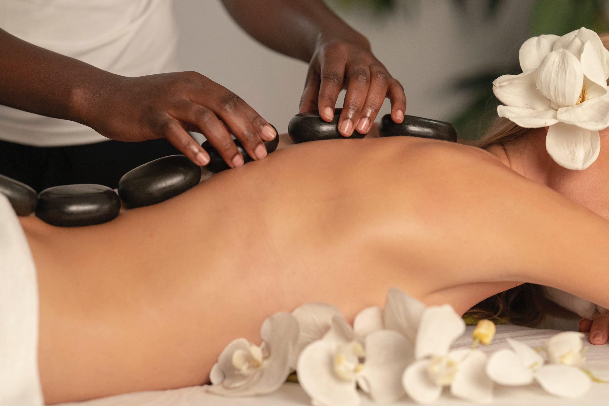 person getting a stone massage