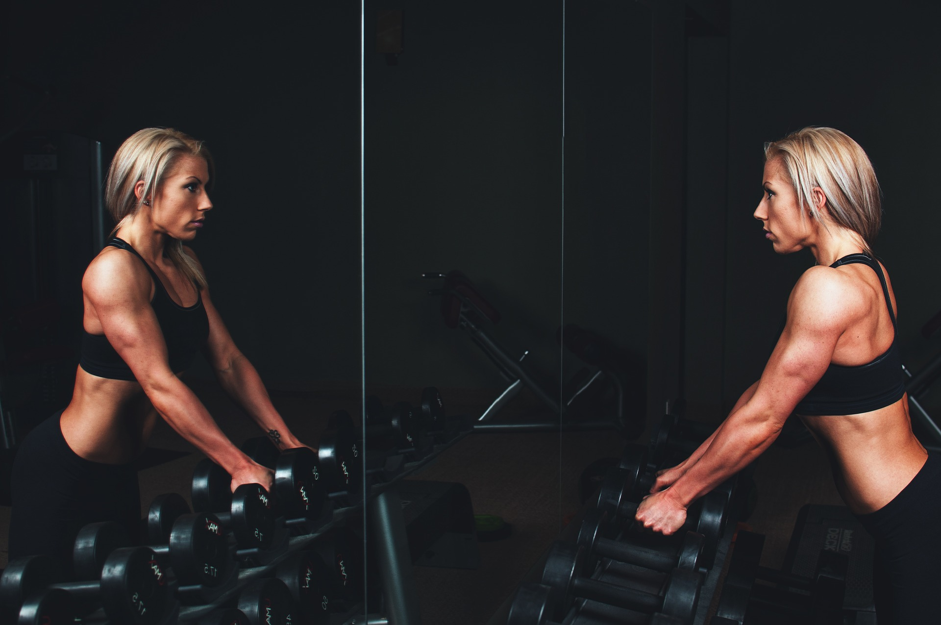 Lady in black working out in a gym