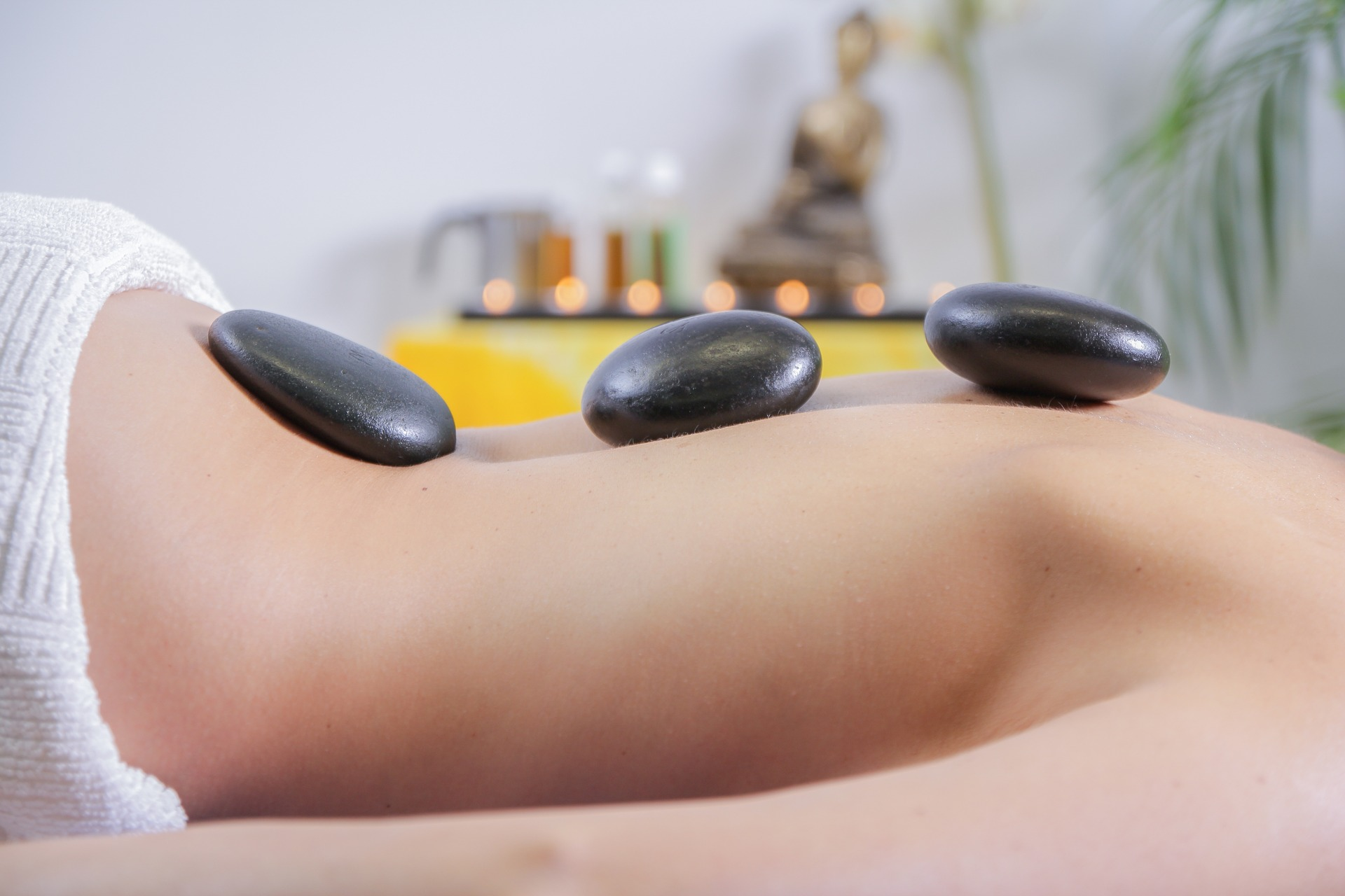 Person getting a hot stone massage